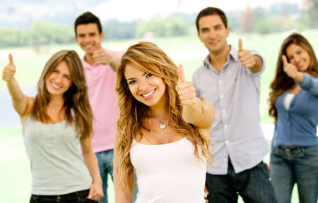 like hand: Group of young people with thumbs up outdoors  Stock Photo