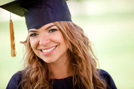 Portrait of a female gradutation student smiling outdoors  photo