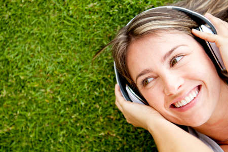 Happy woman portrait listening to music with headphones photo