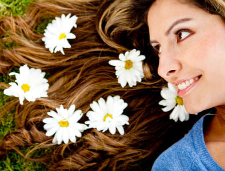 Woman with flowers in her beautiful hair  photo