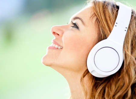 Woman portrait with headphones listening to music  photo