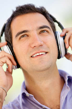 Man portrait listening to music with headphones photo