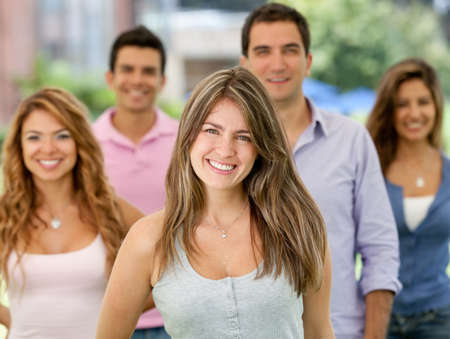 Happy group of young people smiling outdoors  photo