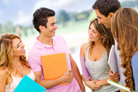 laugher: Friendly group of students talking and having fun - outdoors