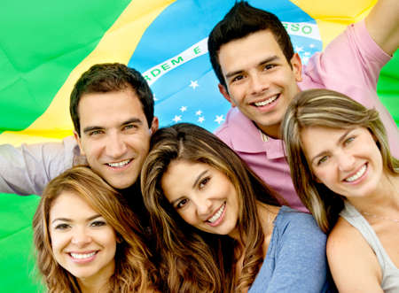 brazilian flag: Brazilian group of people with the flag of Brazil