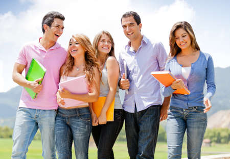 Group of students talking a walk outdoors and smiling  Stock Photo - 12393816