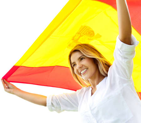 Patriotic woman holding up the Spanish flag  photo