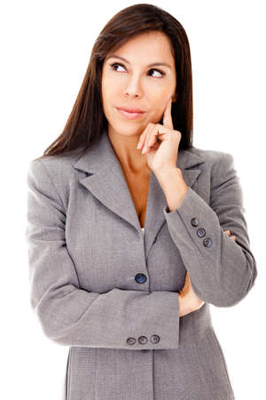 Pensive businesswoman looking up - isolated over a white background photo