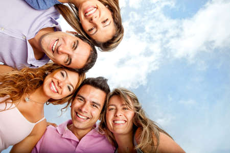 a person: Group of close friends smiling looking very happy  Stock Photo