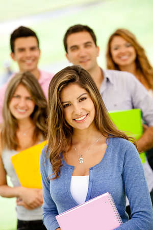 Group of college students holding notebooks and smiling  photo