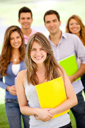 Group of students holding notebooks and smiling  photo