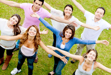 Group of people with arms open enjoying outdoors  Stock Photo - 12393845