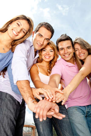 male friends: Group of young people with hands together - teamwork concepts