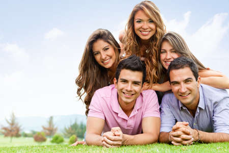 outgoing: Happy group of friends hanging out outdoors  Stock Photo