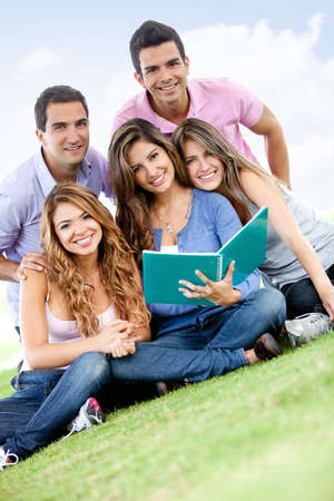 Group of young people studying outdoors and smiling  photo