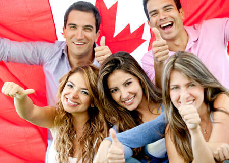 canada: Group of young people with thumbs up and the flag of Canada