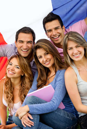 Happy group of French students with the flag of France photo