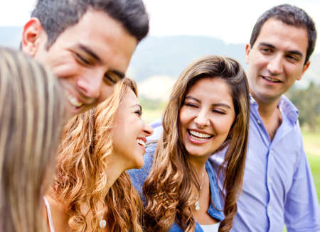 sociable: Group of friends hanging out outdoors having fun  Stock Photo