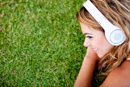 Woman listening to music and relaxing outdoors  photo