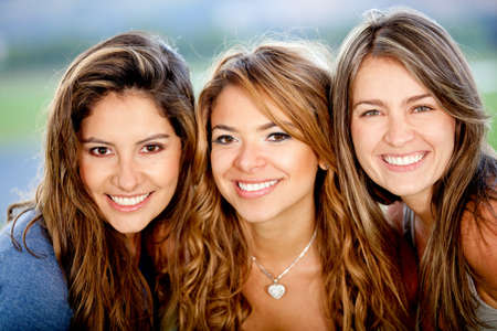 hanging woman: Portrait of a group of beautiful female friends smiling