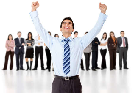 Businessman celebrating with arms up with his group - isolated over a white background  photo
