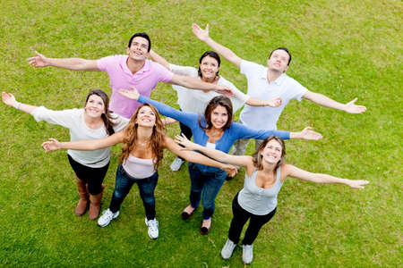 arms up: Group of people with open arms outdoors looking up  Stock Photo