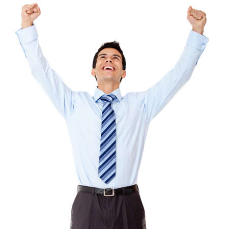 Successful business man celebrating with arms up - isolated over white  photo