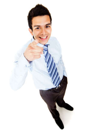 Businessman pointing at the camera - isolated over a white background photo