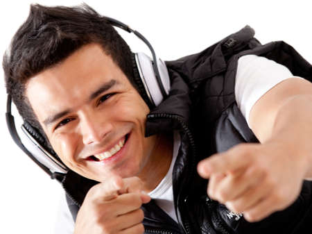 Male DJ smiling with heaphones - isolated over a white background photo