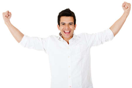 Happy man with arms up and smiling - isolated over a white background photo