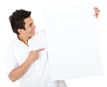 Casual man pointing at a banner - isolated over a white background photo
