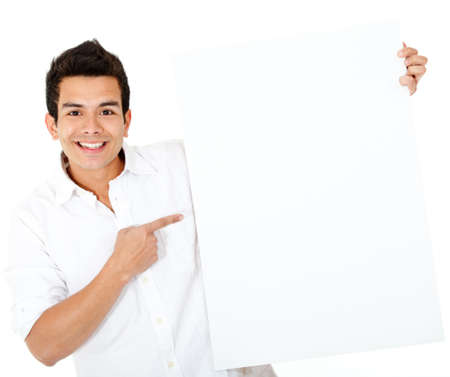 Casual man pointing at a banner and smiling - isolated over white  photo