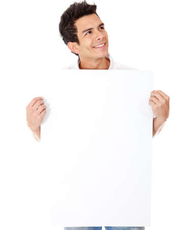 Casual man holding a banner and smiling - isolated over a white background photo