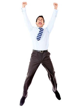 leaping: Excited businessman celebrating and jumping - isolated over a white background