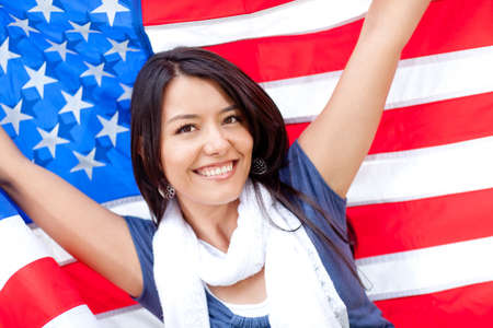 american content: Proud woman with the American flag and smiling