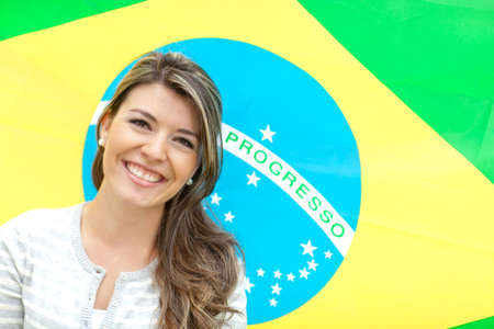 Beautiful young woman with the flag of Brazil  photo