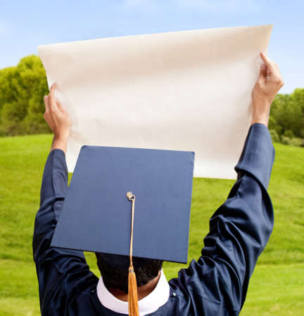 Graduation man holding paper (copy space) - isolated over a white background photo