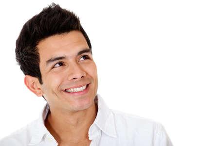 hombre pensando: Hombre pensativo sonriendo - aislados en un fondo blanco