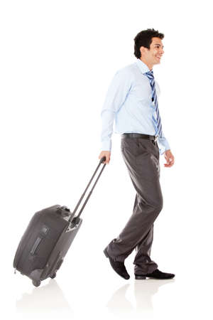Businessman with his bag going on a trip  - isolated over a white background photo