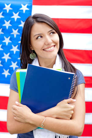 English female student with the American flag at the background photo