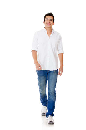 Casual man walking - isolated over a white background Stock Photo - 12620098