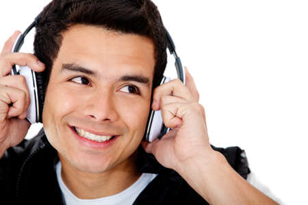 Happy man portrait with headphones - isolated over a white background photo