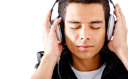 listen to music: Man listening to music and relaxing - isolated over a white background Stock Photo