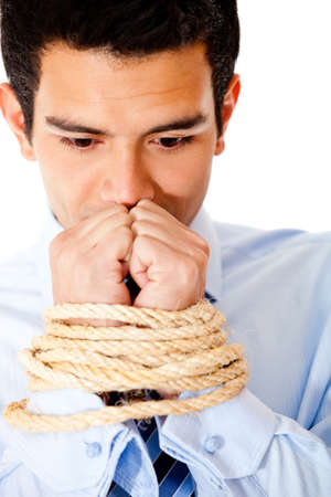 hijacked: Businessman with hands tied  using a rope - isolated over a white backround  Stock Photo