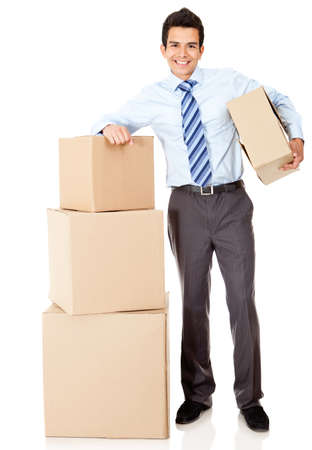 Businessman moving office and packing in boxes – isolated photo