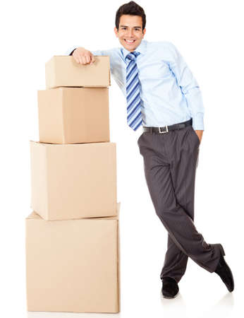 Businessman packing in carton boxes and getting ready for moving - isolated photo