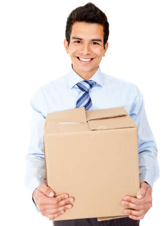 Businessman moving office holding a box - isolated over a white background photo