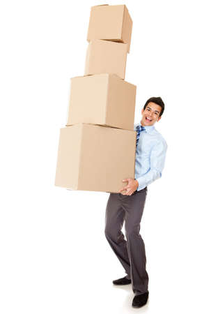 Businessman carrying heavy boxes - isolated over a white background photo