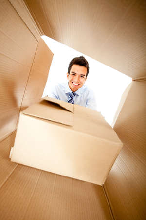 Businessman getting a special delivery and smiling  photo