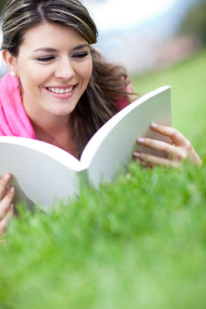 Portrait of a girl studying outdoors with a book  photo